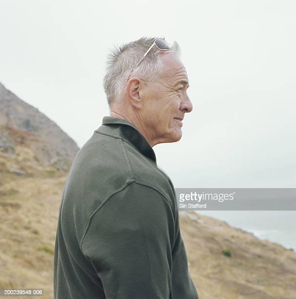 Mature man standing on overlook, profile