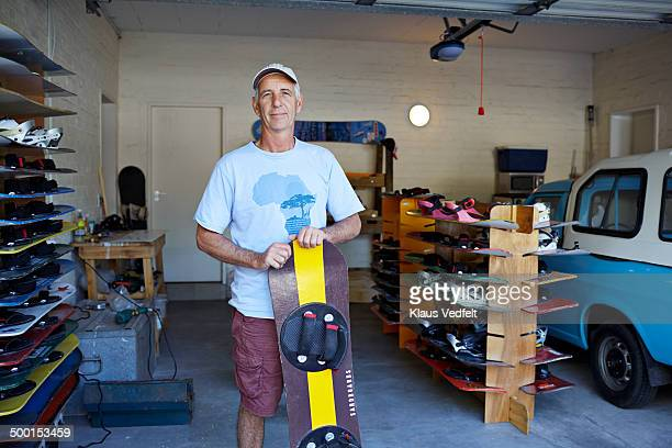 Mature man standing with his self made sandboard