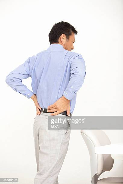 Mature man suffering from pain on back