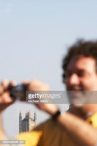 Mature man taking photograph outdoors