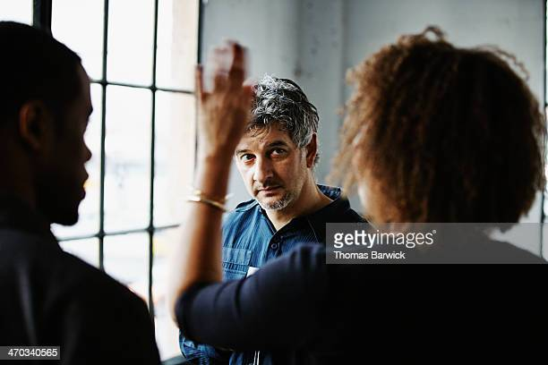 Mature man talking with friends at dinner party