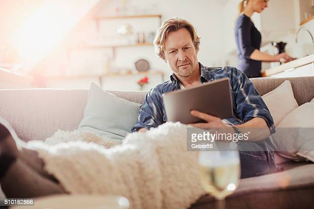 Mature man using digital tablet
