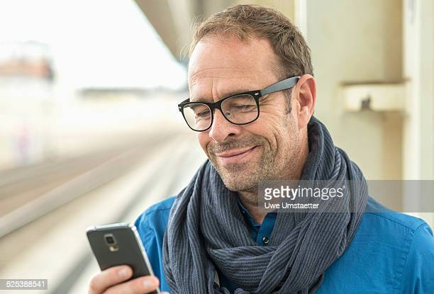Mature man using smartphone