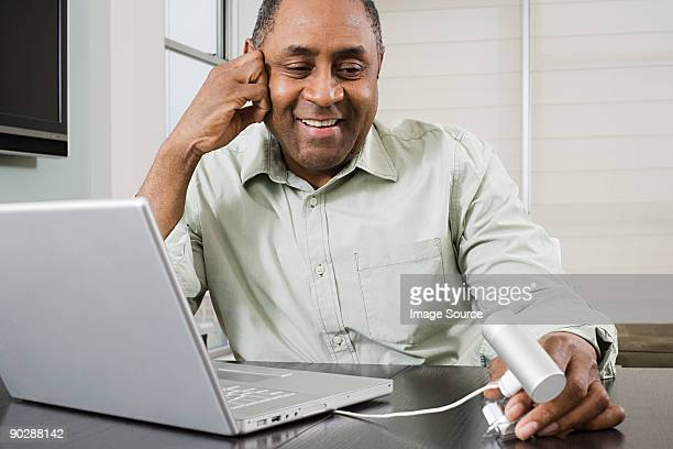 Mature man using webcam