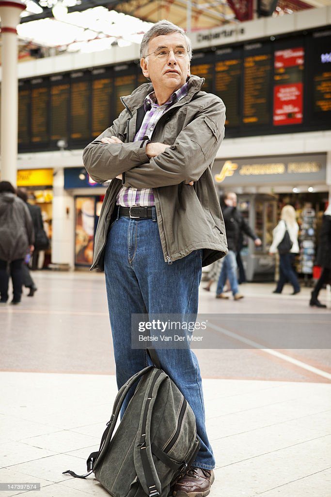 Mature man waiting at railway station. : Stock Photo