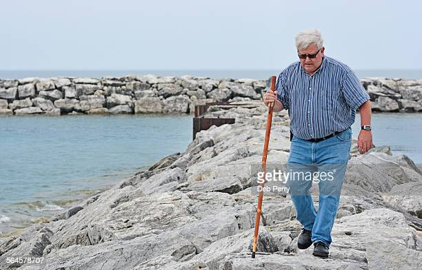 Mature man walking on breakwater