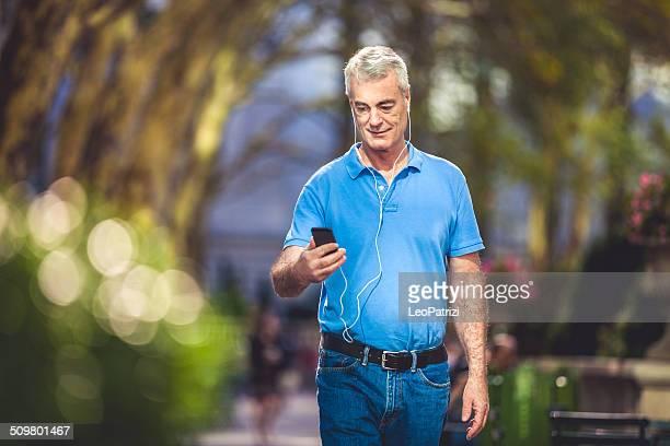 Mature man walking through the park
