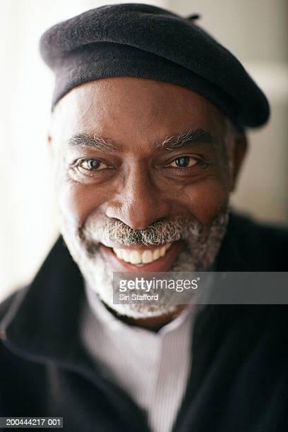 Mature man wearing beret, smiling