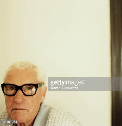 Mature man wearing black rimmed glasses, portrait