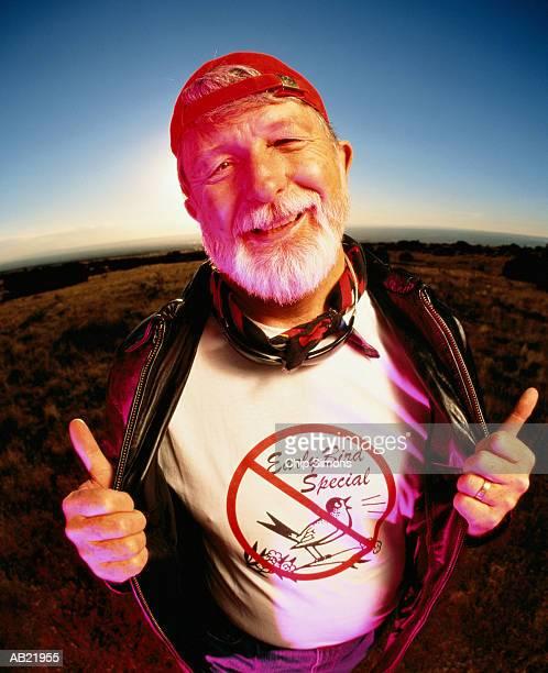 Mature man wearing 'Early Bird Special' t-shirt, portrait