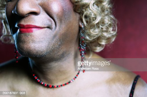 Mature Guy In Necklace And Wig