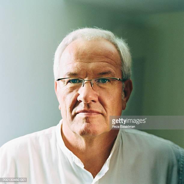 Mature man wearing white shirt, portrait