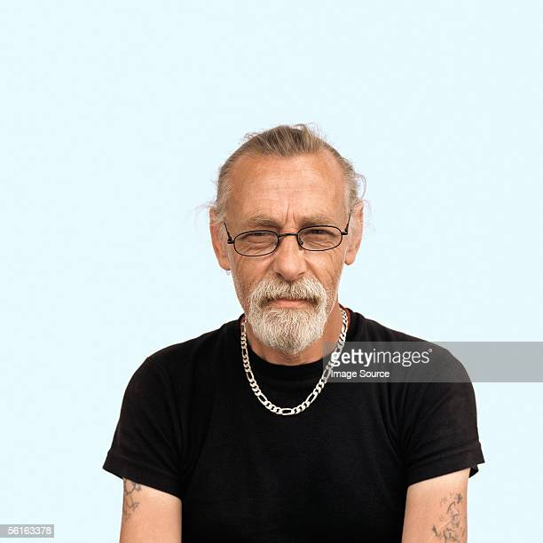 Mature man with a ponytail