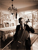 Mature man with cello (toned B&W)