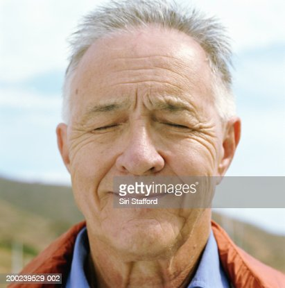 Mature man with eyes closed, close-up : Stock Photo