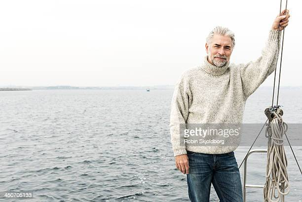 Mature man with grey hair on sailingboat