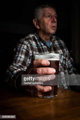 mature man with large glass of lager - UK : Stock Photo