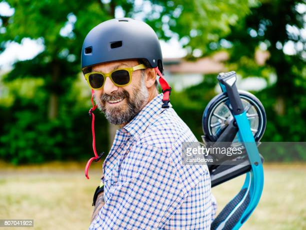 Mature man with scooter