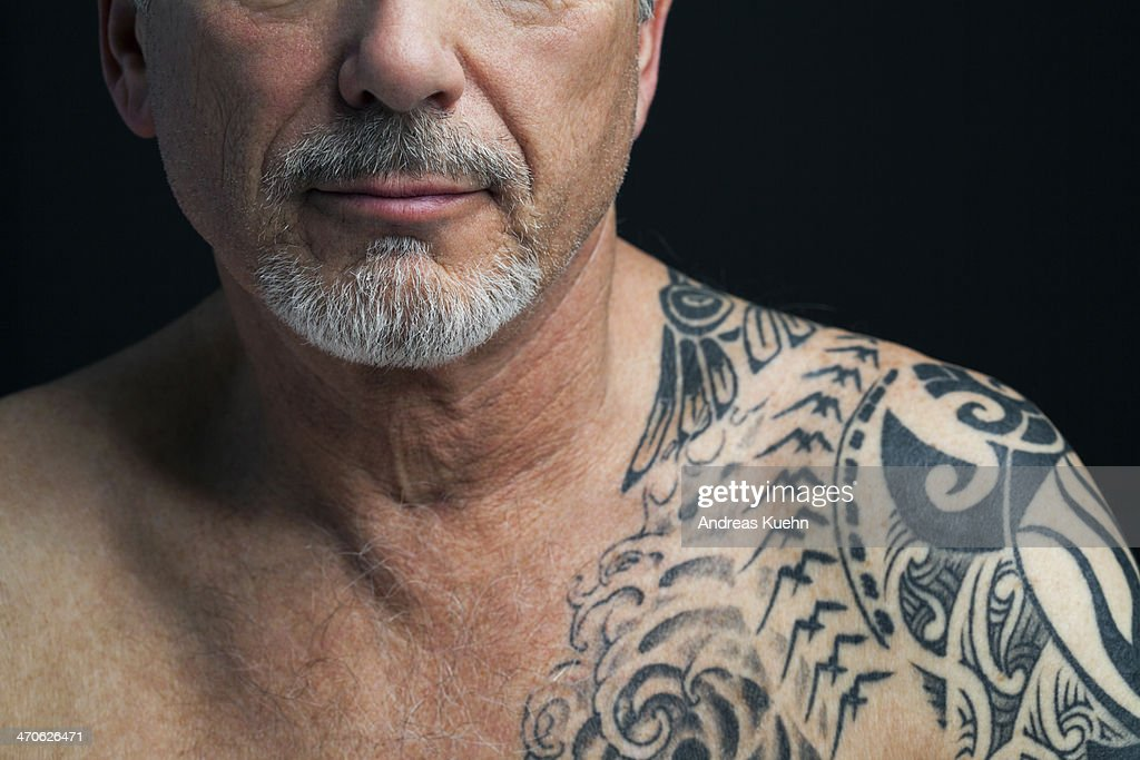 Mature man with tattoo on shoulder, cropped. : Stock Photo