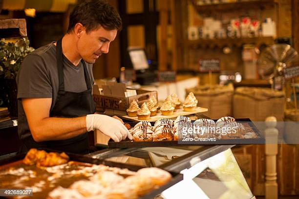 Mature man with tray of fresh pastries