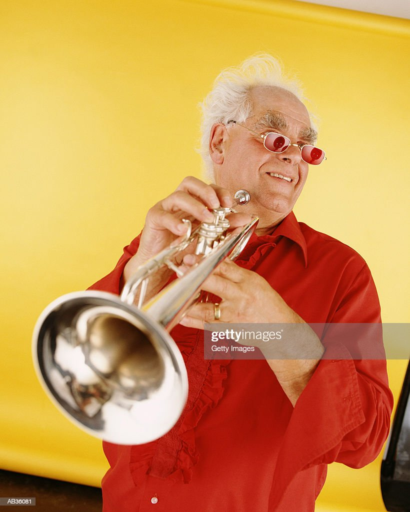 Mature man with trumpet : Stock Photo