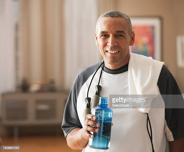 Mature man with water  bottle after workout