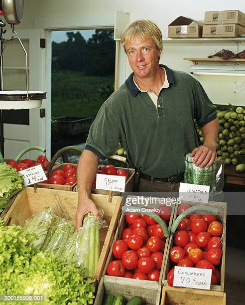 Mature man working at produce stand, portrait