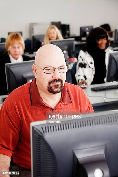 Mature man working in a computer lab