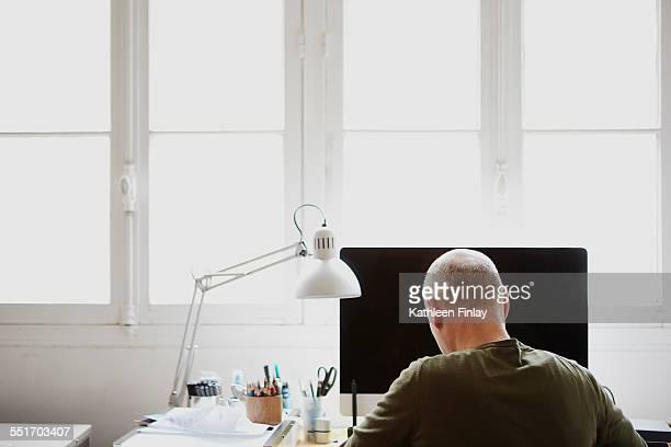 Mature man working in creative studio