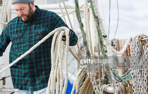Mature man working on commercial fishing boat : ストックフォト