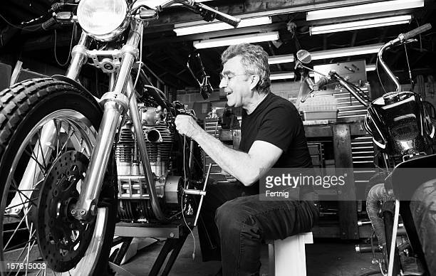 Mature man working on his classic motorcycles