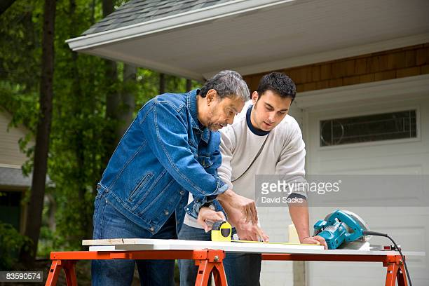 Mature man working with son