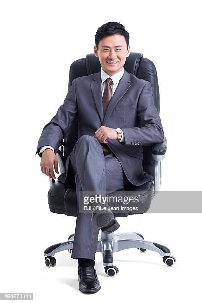Mature manager sitting in chair