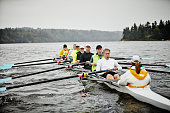 Mature men rowing eight person rowing shell