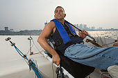 Disabled man in a boat for adaptive sailing