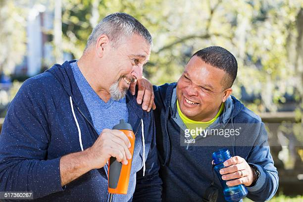 Mature men taking exercise break