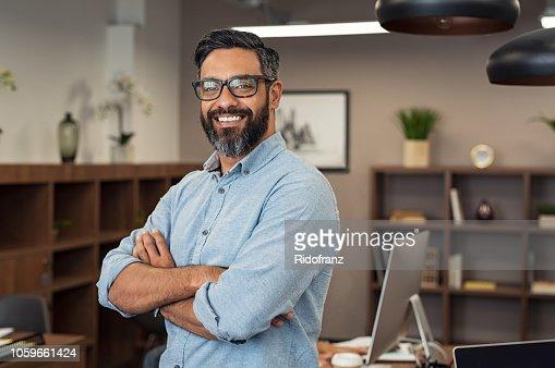 Mature mixed race business man : Stock Photo