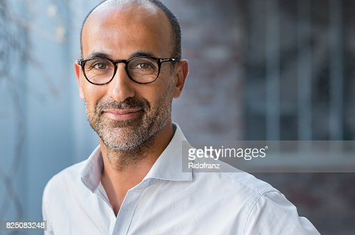 Mature mixed race man smiling : Stock Photo