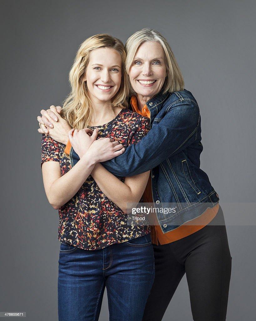 Mature mother hugging daughter, portrait
