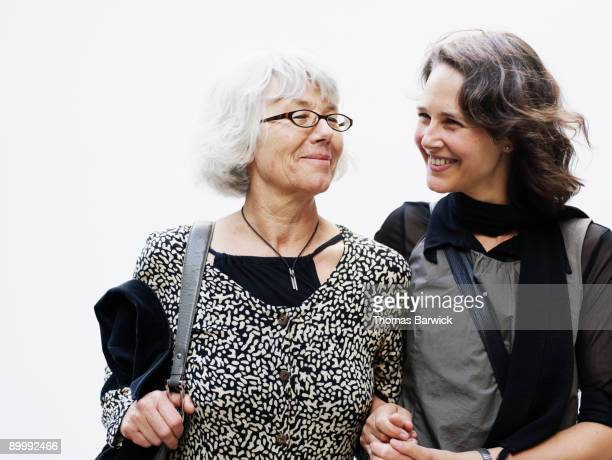 Mature mother with daughter holding hands