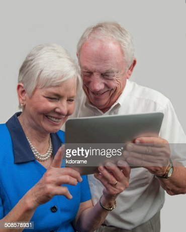 Mature People Engaged in Computer Tablet : Stock Photo