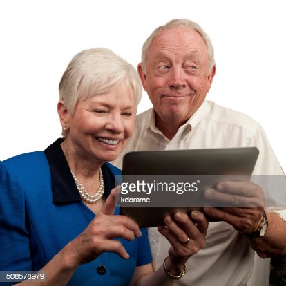 Mature People Holding Computer Tablet : Stock Photo