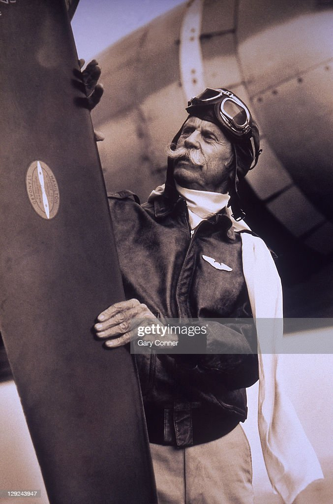 Mature pilot with vintage airplane : Stock Photo