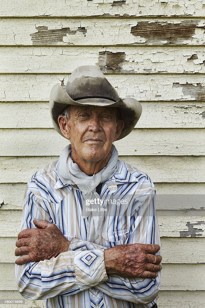 Mature Rancher cowboy arms folded : Stock Photo