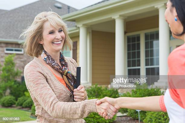 Mature real estate agent meeting future homeowner