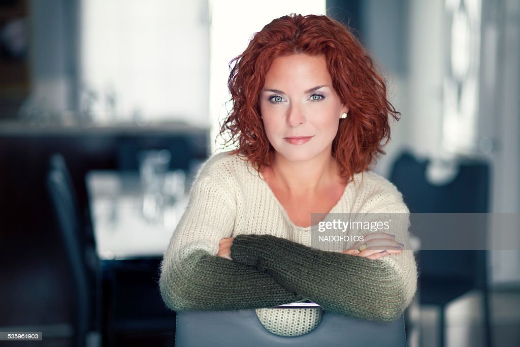 Mature red woman smiling at the camera : Stock Photo