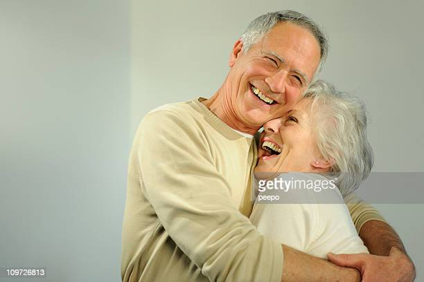 Mature senior couple hugging.