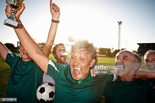 Mature soccer players celebrating