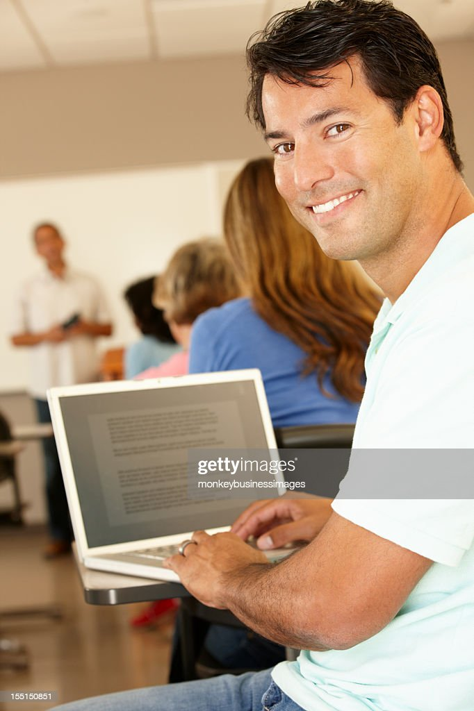 Mature student in class : Stock Photo