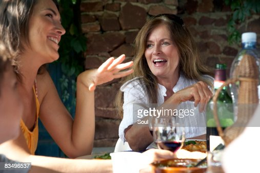 mature woman and daughter eating lunch outdoors : Stock Photo